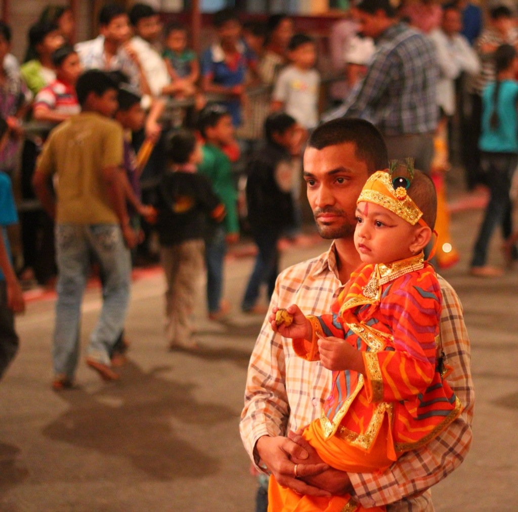 Child and father at festival in India