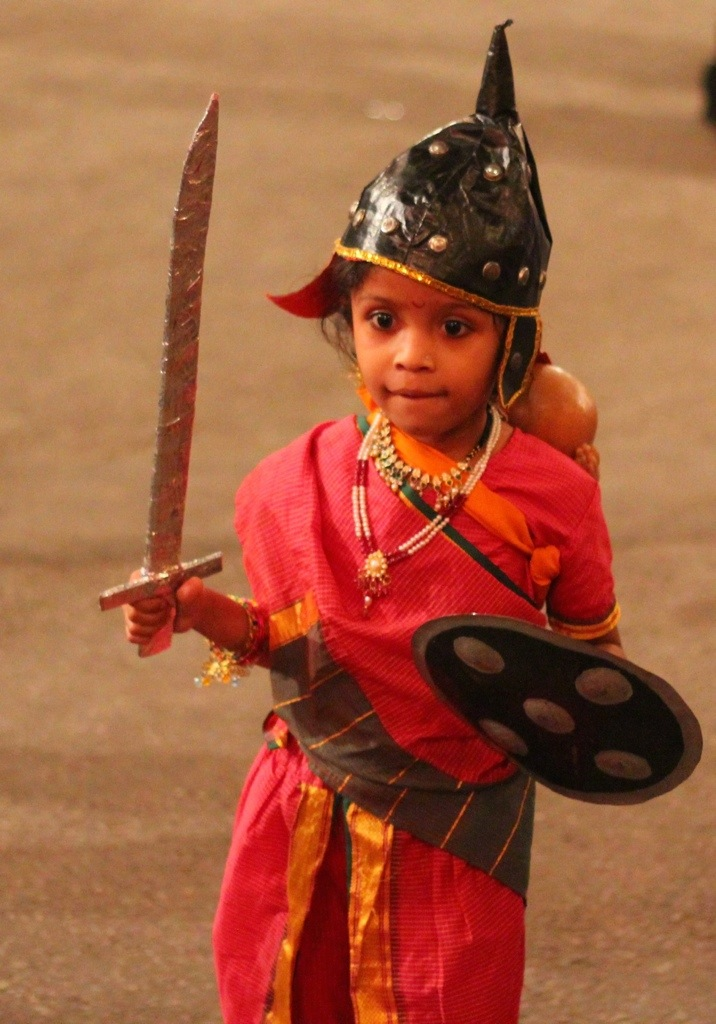 child dressed as a warrior at Navratri festival