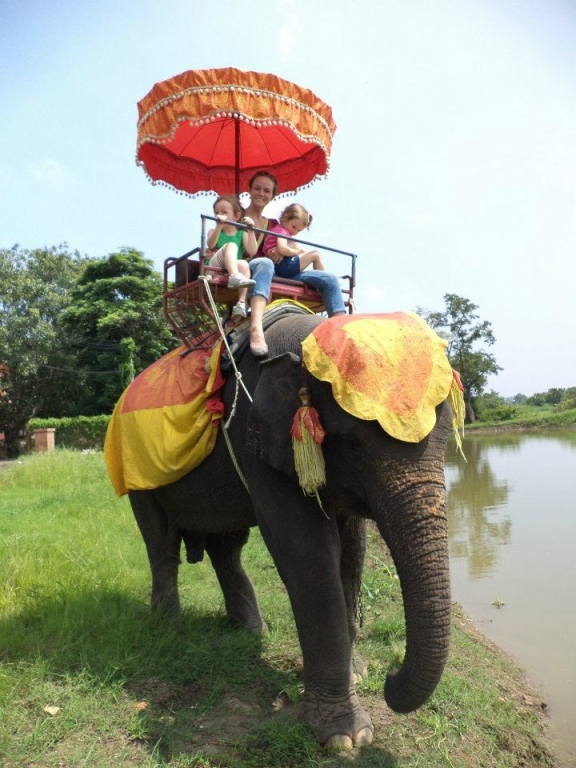 Becky and the girls riding an elephant at Ayutthaya National Park, Thailand.