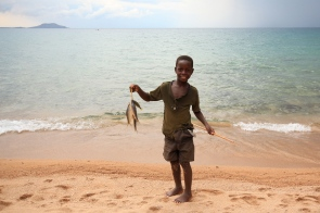 Boy showing off the catch of the day