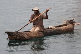 Local man in dugout canoe