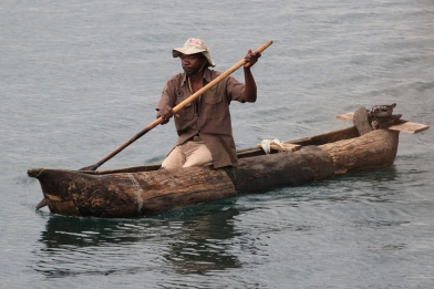 Local man in dugout canoe