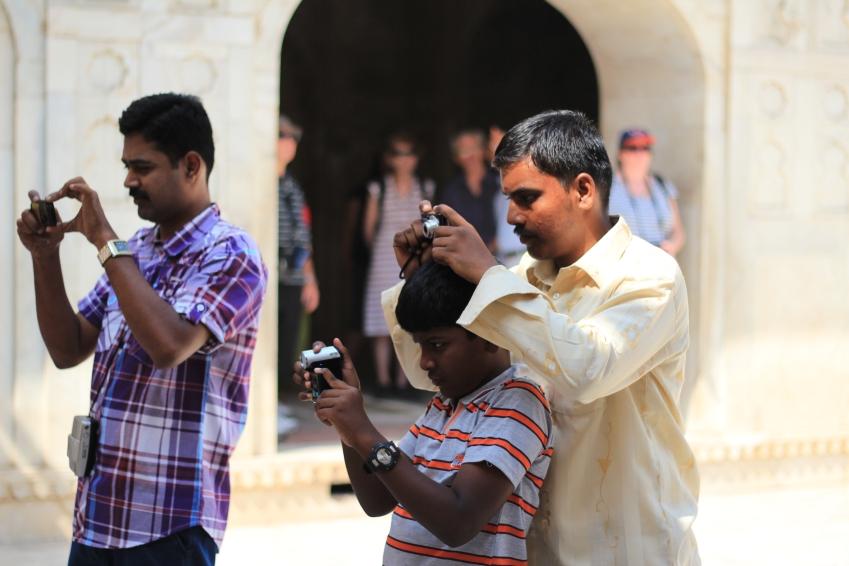Paparazzi-like locals taking photos of Kristi