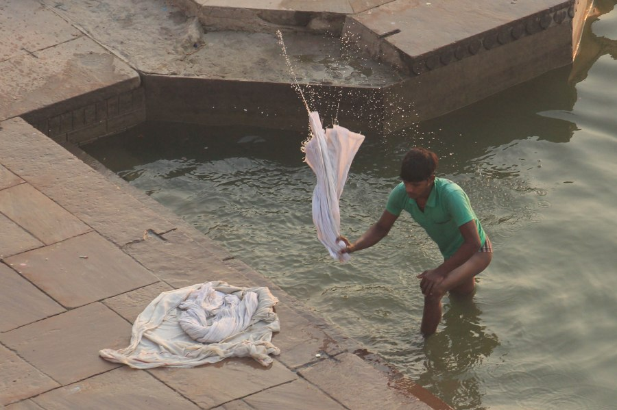 Man doing laundry on the Ganges