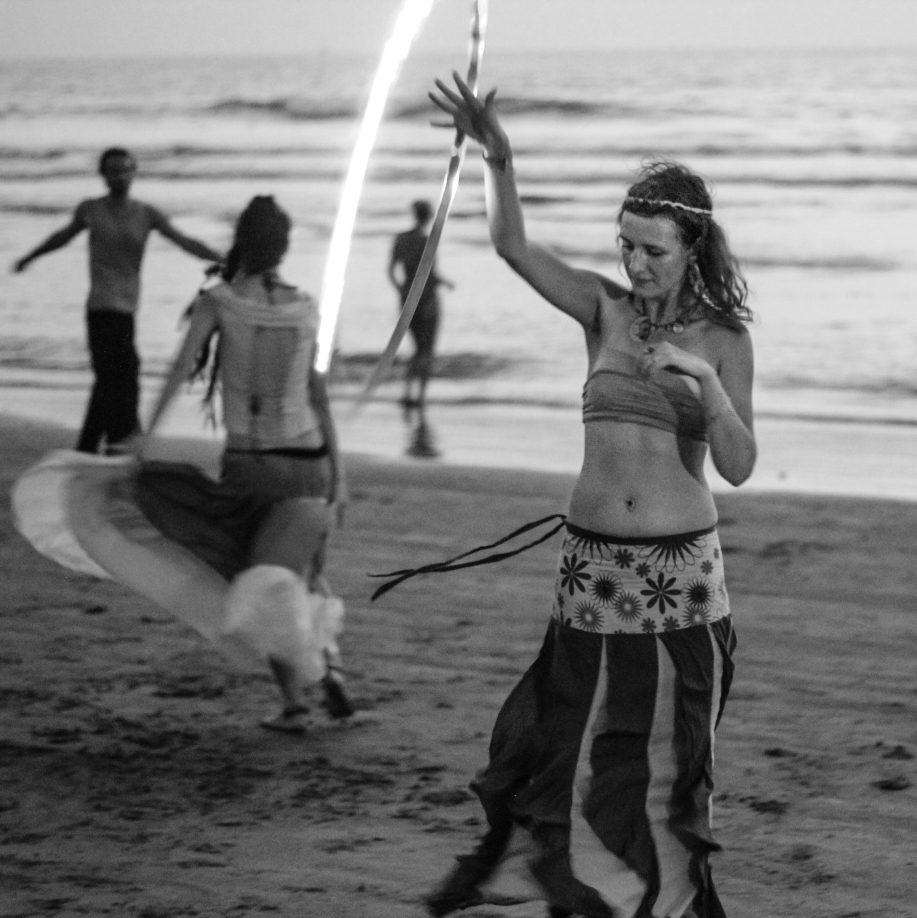Hippie dancing on a beach in Goa