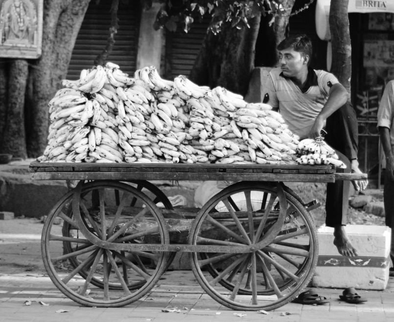 man selling bananas in Delhi