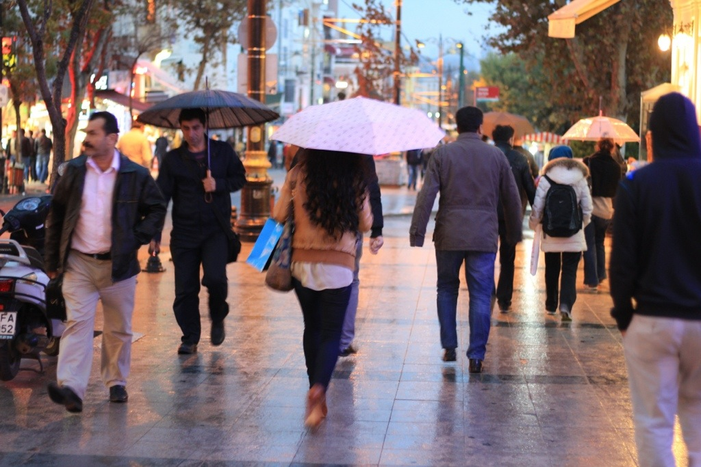 people walking through Istanbul in the rain