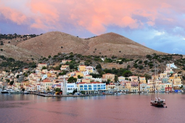 Symi, Greece, under a pink sunrise.