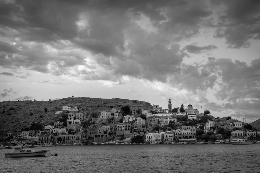 Church tower and clouds above Symi, Greece.