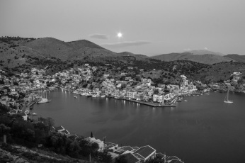 Moonset over Symi in black and white