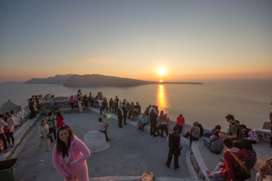 Santorini tourists watching the sunset.