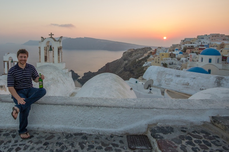 Jeff Bell drinking a beer in Santorini
