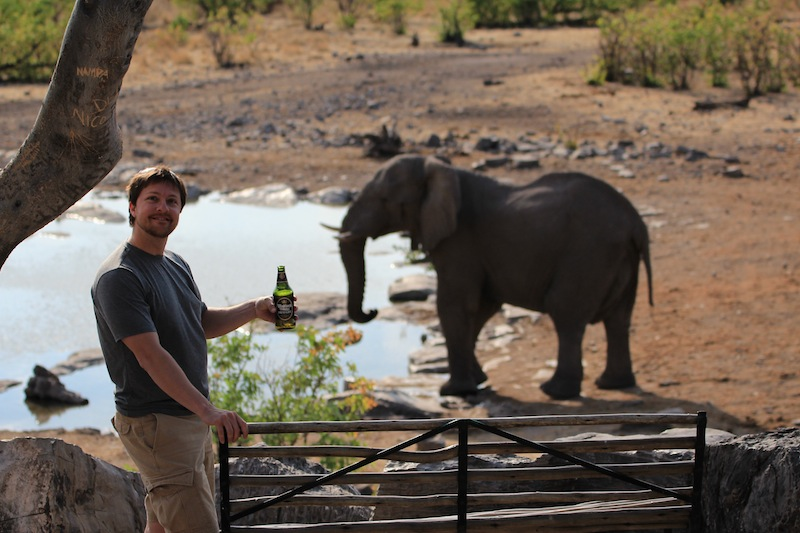 Jeff Drinking Beer in front of Elephant.