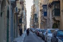 Priest and businessman in Valletta.