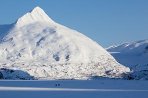 Hikers, Skiers and Pets on Portage Lake in the Winter.