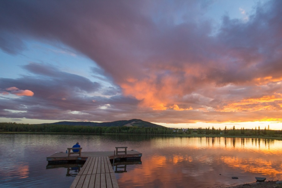 Man watching sunset Otto Lake