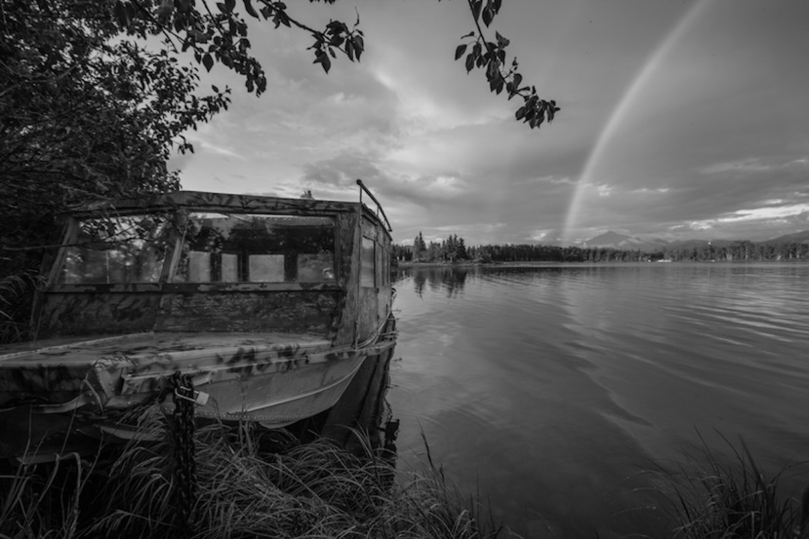 Fishing boat and rainbow