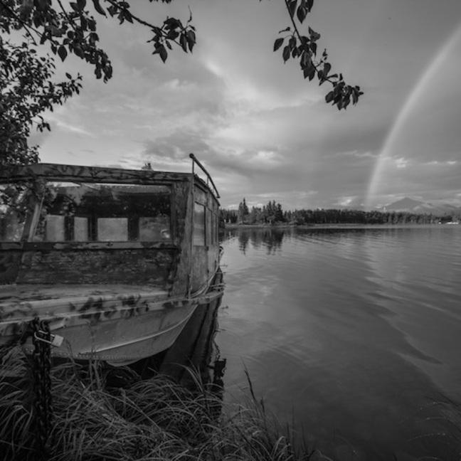 Fishing boat and rainbow