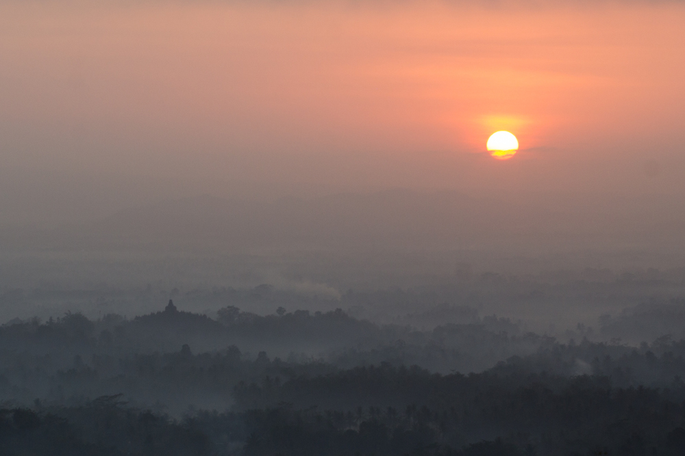 Sunrise over Borobudur from a nearby hill.