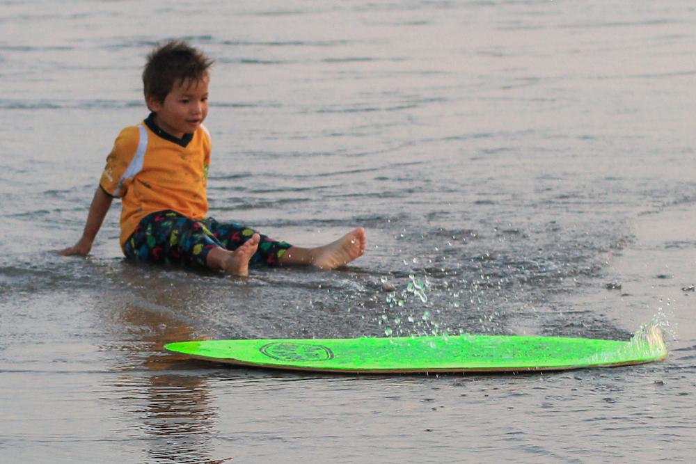 Surfing boy in Bali