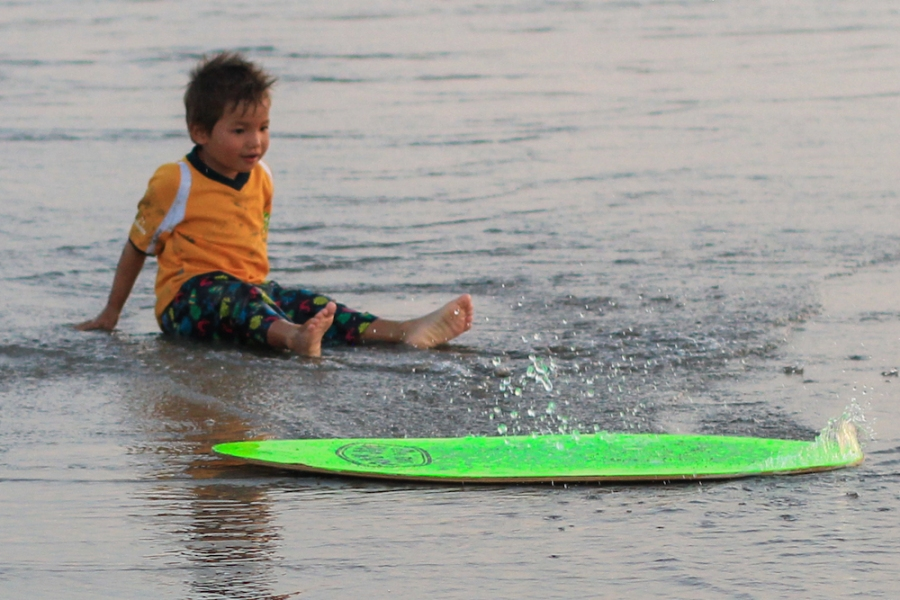 Surfing boy in Bali