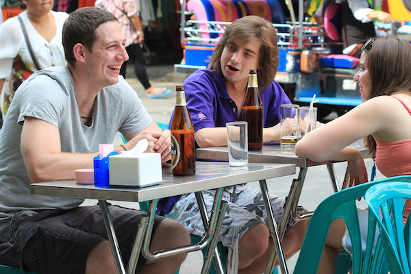 Friends drinking on Khao San Road