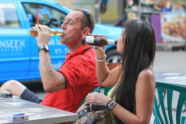 Asian lady drinking beer