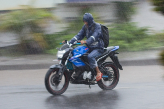 Motorcycle in rain, Bajawa