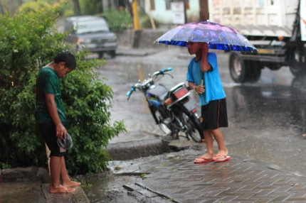 Kids playing in the rain Indonesia