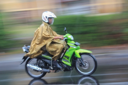 Motorcyclist with tarp, Bajawa