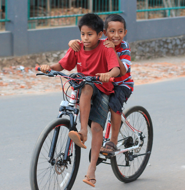 Two boys on a bike