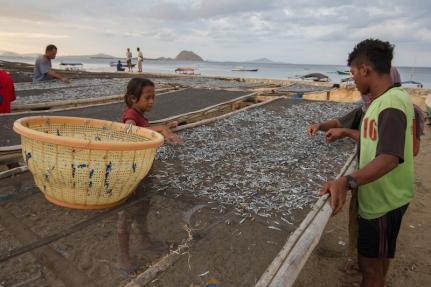 Locals drying fish.
