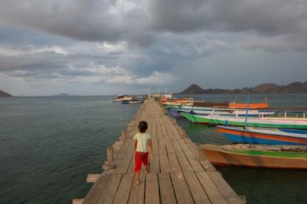 Girl on a pier at Rinca Island.