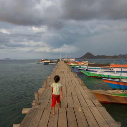 Girl on a pier at Rinca Island.