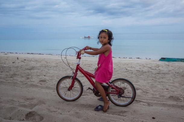 Girl on Bira Beach with Bike