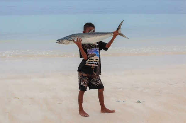 Boy with a fish in Bira