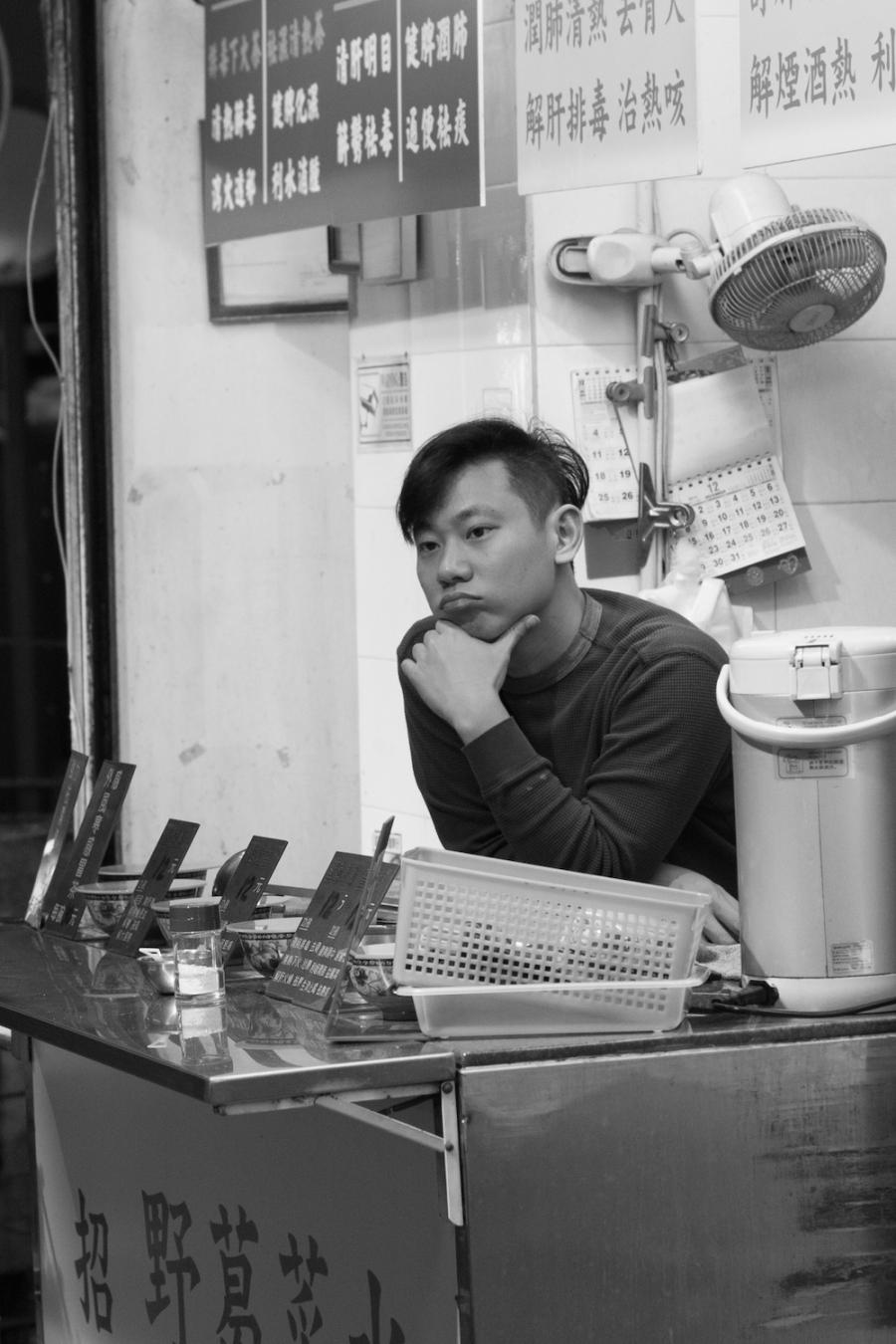 Pensive shop keeper