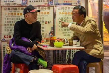 Two men at a cafe in Hong Kong