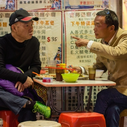 Two men at a cafe in Hong Kong