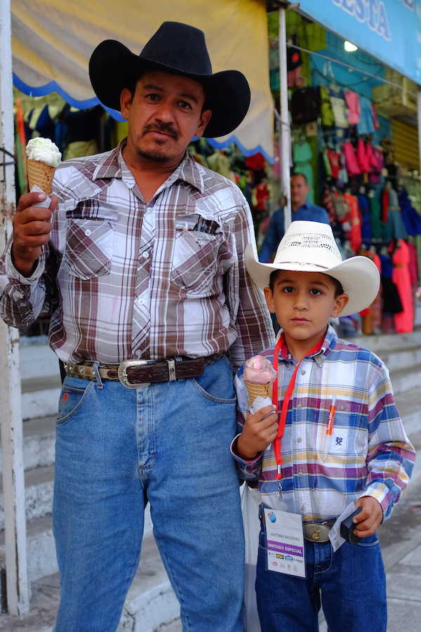 Mexican cowboy and son