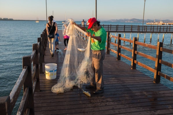 La Paz Malecon fisherman