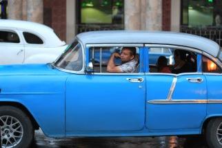 Man in classic car in Cuba