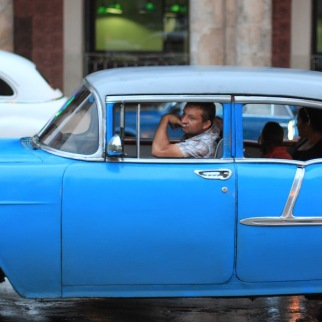 Man in classic car in Cuba