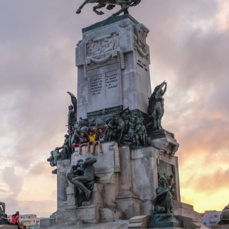 Statue and sunset in Havana