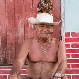 Cuban man with rooster in Trinidad