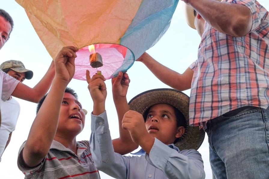 Boy lights a lantern, Zozocolco