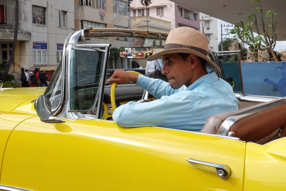 Man Driving yellow Car