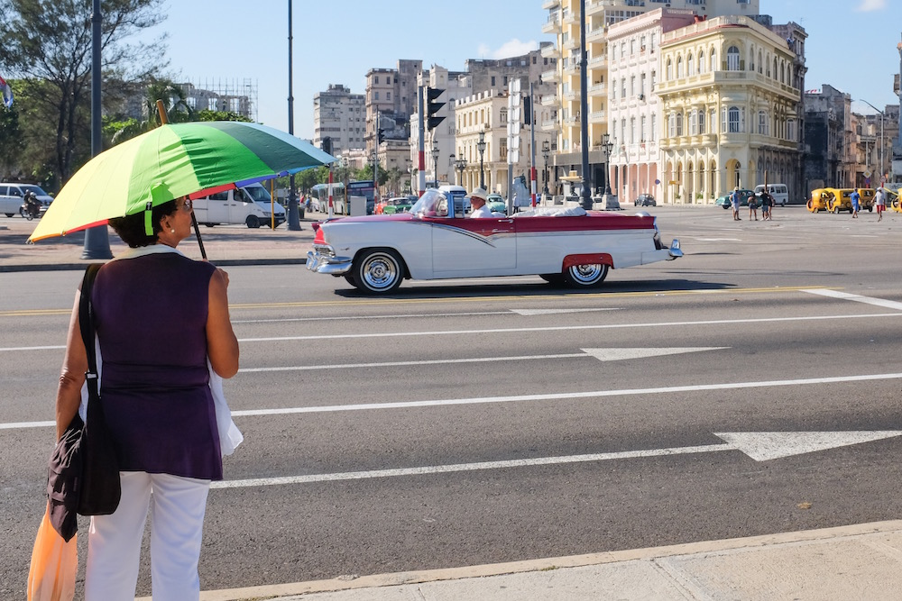 Havana classic car and lady with umbrella