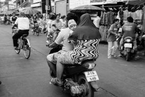 Muslim family on a bike