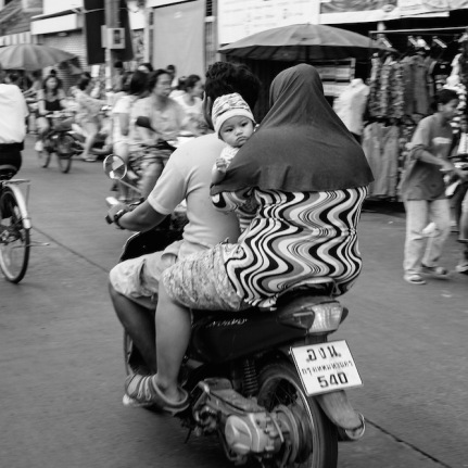 Muslim family on a bike